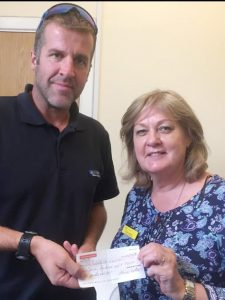 Vice President Ricky Reid presents cheque to Kathy Graham of Cowal Community Palliative Care Team